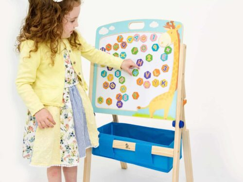 Young girl using the art easel