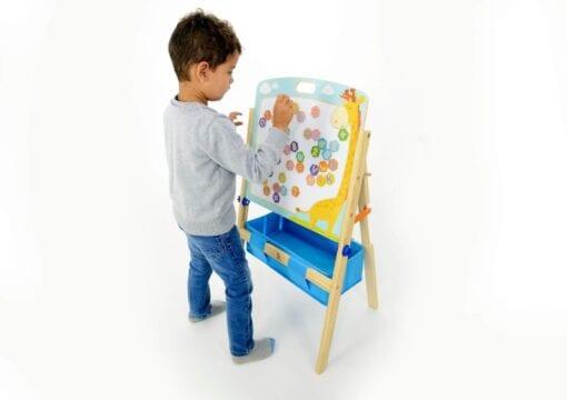Boy using the art easel