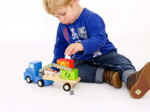 Child playing with container loader
