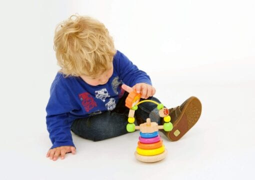 Young boy playing with Lion stacker