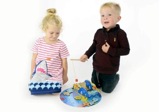Children playing with Pirate fishing game