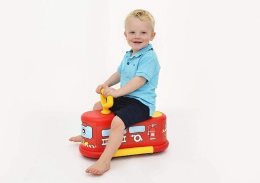 Child playing with ride on fire engine