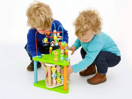 Children playing with an activity centre
